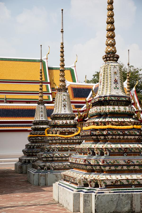 View of three pagodas from the Emerald Buddha temple in Bangkok. With copy space stock photo