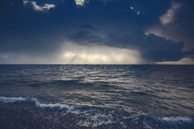 View of thunderstorm clouds above the sea. Toning color royalty free stock photography