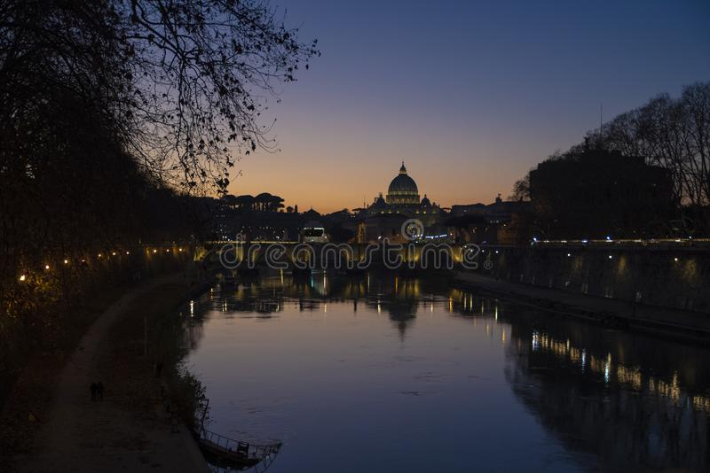 View from the tiber river of St. Peter`s Basilica at sunset, Vatican, Rome, Italy stock photography
