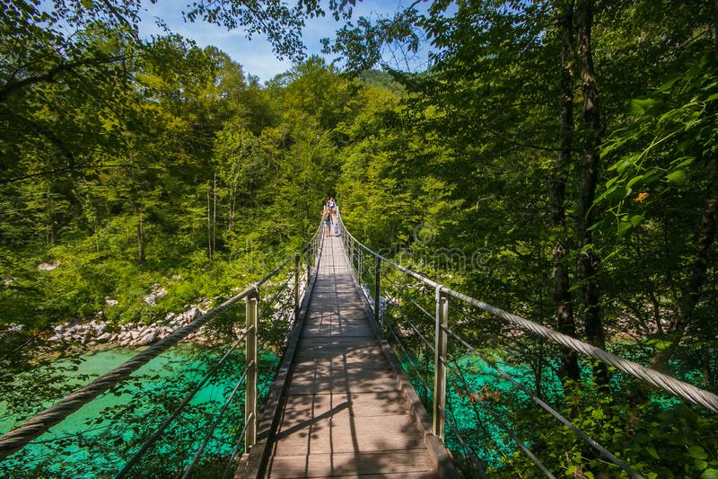 View of Tibetan bridge over Soca river in Slovenia. Europe royalty free stock photos