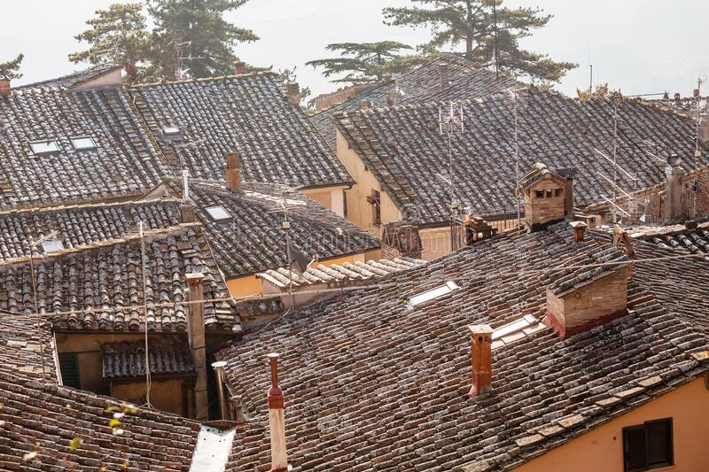 View of tiled roofs of old town in Tuscany. Italy stock photo