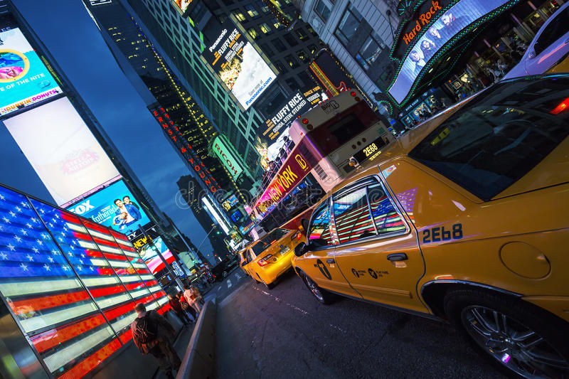 View of Times Square by night. NEW YORK CITY -JULY 10: Times Square, featured with Broadway Theaters and animated LED signs, is a symbol of New York City and the stock images
