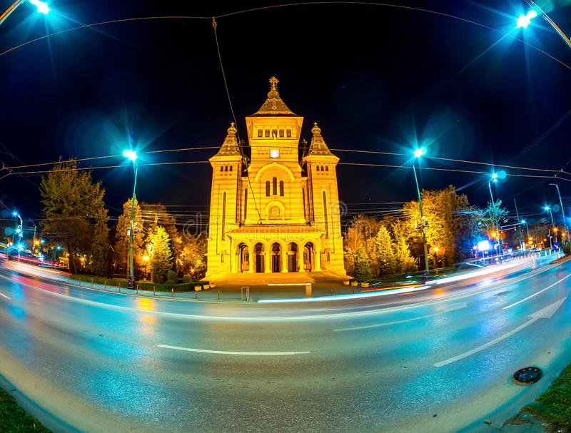 View on the Timisoara Orthodox Cathedral. TIMISOARA, ROMANIA - OCTOBER 15: View on the Timisoara Orthodox Cathedral as traffic passes by at the historical royalty free stock image