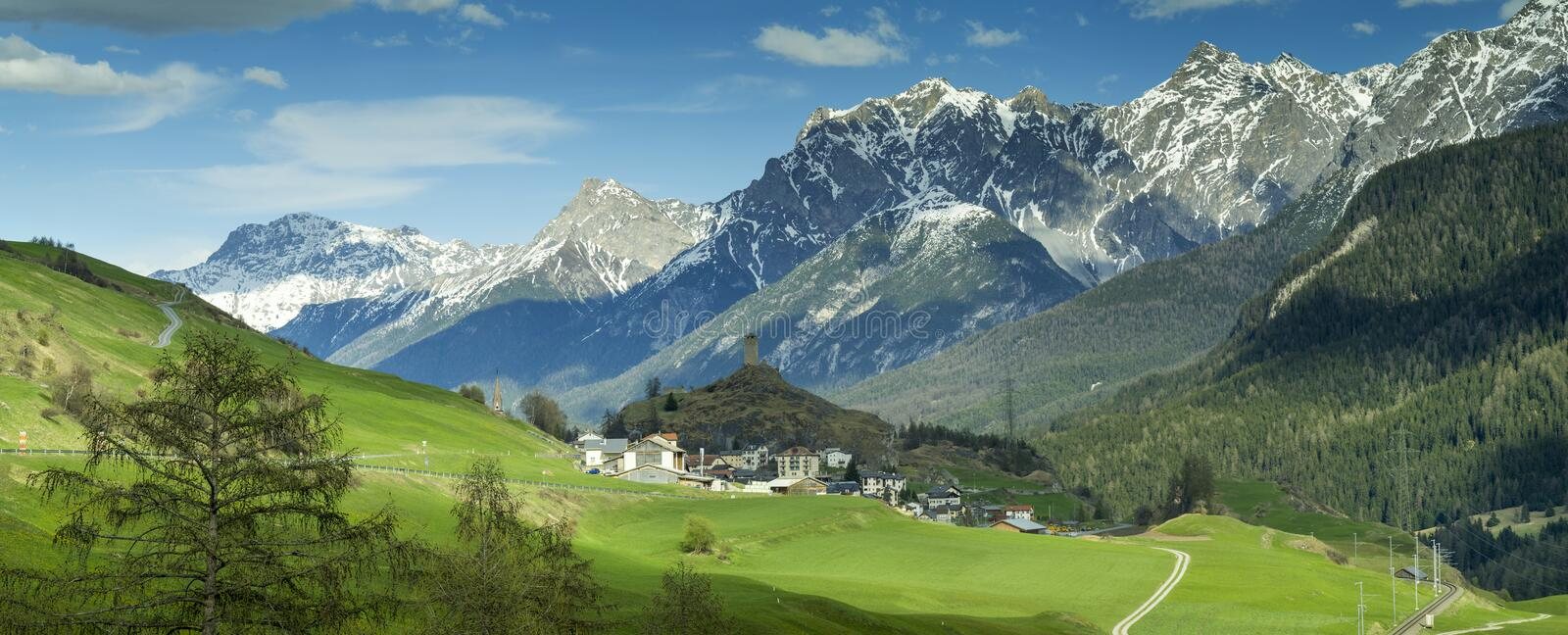 View to alpine valley in spring day stock photography
