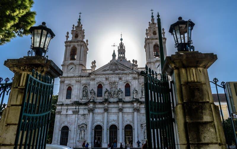 View to the Basilica da Estrela framed by the gates of Jardim da Estrela, Lapa - Portugal stock images