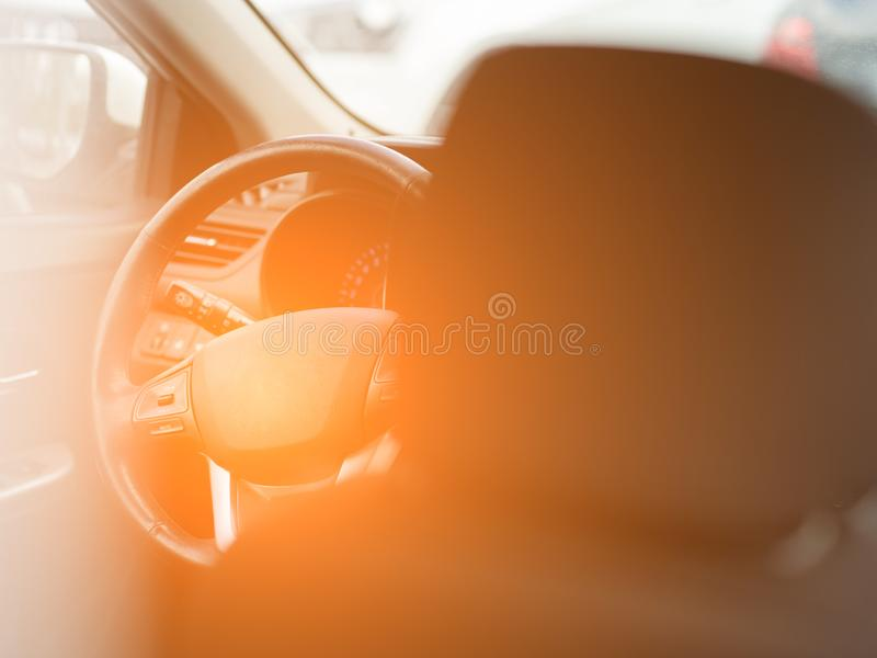 View to the black color interior of car with front seats, steering wheel and dashboard . Auto service industry. View to the black color interior of car with royalty free stock photography
