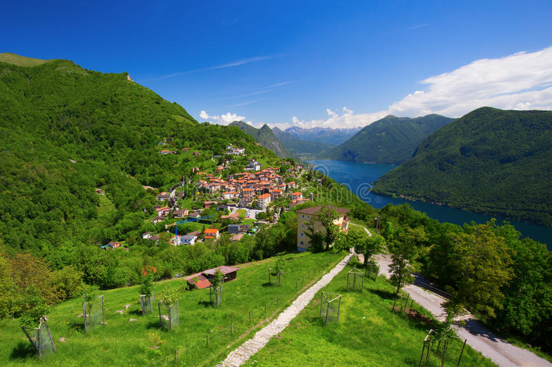 View to Bre village, Lugano lake and Allps from Monte Bre, Ticino, Switzerland. Beautiful View to Bre village, Lugano lake and Allps from Monte Bre, Ticino stock photo