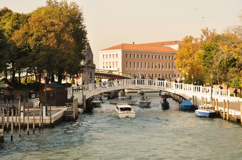 View to Calatrava bridge, Venice. Grand Canal, boats and ferryboats, near Rome Square with view to Calatrava bridge royalty free stock images