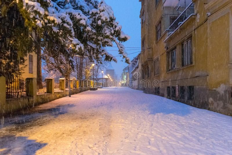 View to the Cetatii street in the historical center of Sibiu on a winter evening in Transylvania Region, Romania stock images