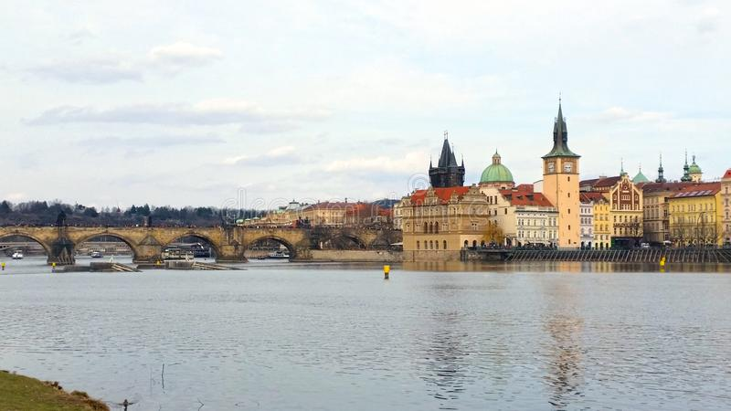 View to Charles bridge in Prague from nearest island stock photography