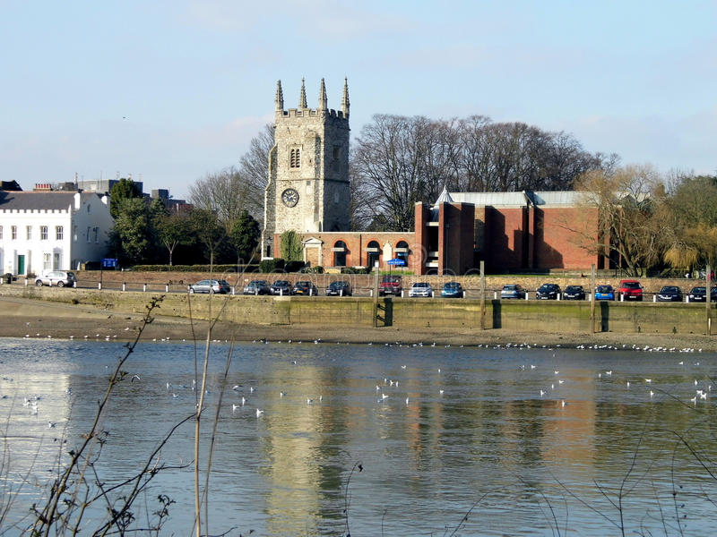 View to church across the river. Looking across to the church from the River Thames just beyond Richmond, Surrey royalty free stock image