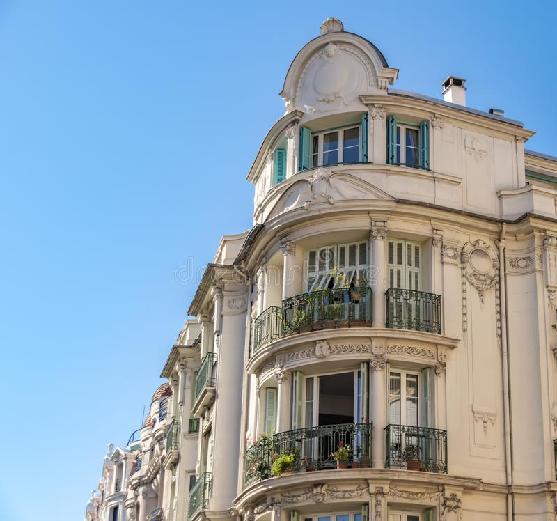 Decorated facade of a historic house in Nice, France. You can see the typical windows, balconies and shutters of a Mediterranean c. View to the decorated facade royalty free stock images