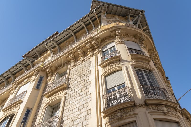 Decorated facade of a historic house in Nice, France. You can see the typical windows, balconies and shutters of a Mediterranean c. View to the decorated facade stock photos