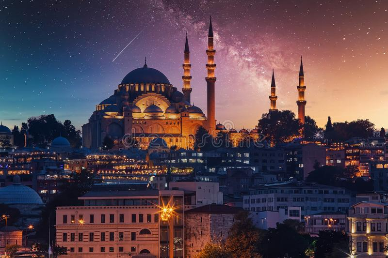 View to Eminonu pier and Suleymaniye mosque across Bay of Golden Horn on starry night stock image