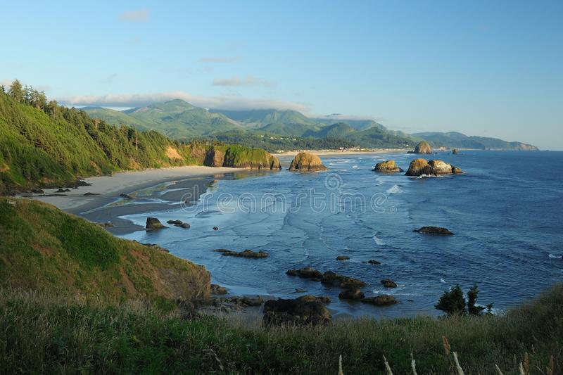 View To Haystack Rock Marine Garden From Ecola State Park In The Early Evening. View To Haystack Rock Marine Garden From Ecola State Park Cannon Beach Oregon USA royalty free stock photo