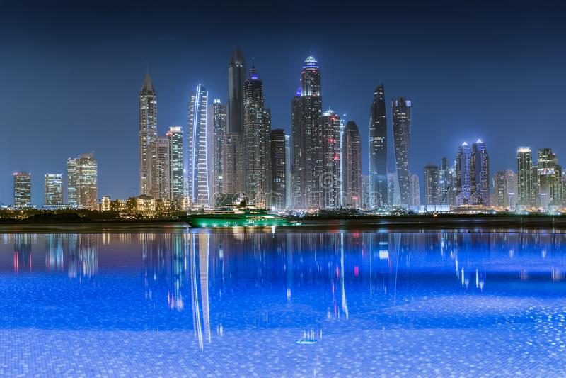 View to the illuminated skyline of the Dubai Marina at night stock images