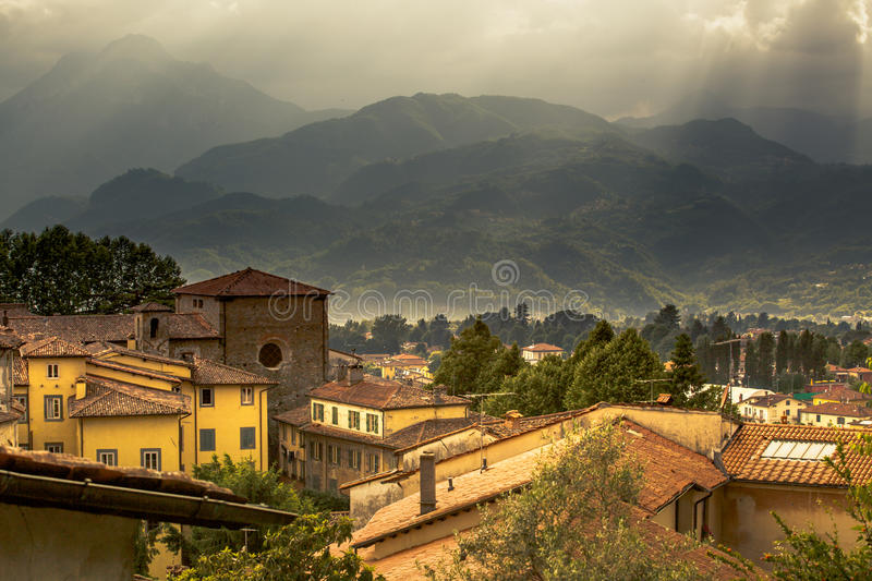 View to Italian medieval mountain village Castelnuovo di Garfagnana. A view to a medieval Italian mountain village Castelnuovo di Garfagnana in a valley royalty free stock photos