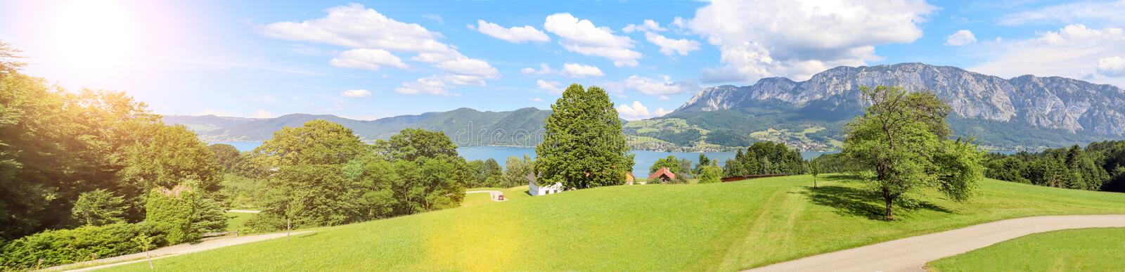 View to lake Attersee with alpine pasture, Mountains of austrian alps near Salzburg, Austria Europe. View to lake Attersee with alpine pasture, Mountains of royalty free stock photography