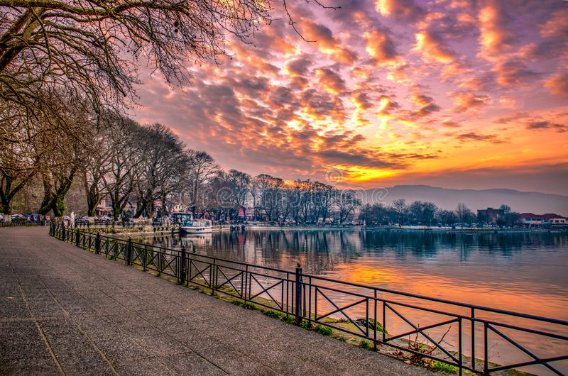 View to the lake Pamvotis at sunset. Ioannina city, Greece stock images