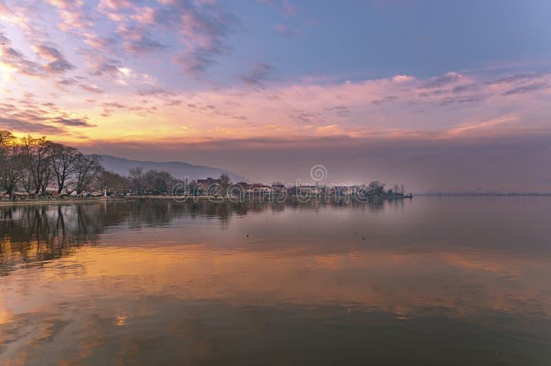 View to the lake Pamvotis at sunset. Ioannina city, Greece. stock photography