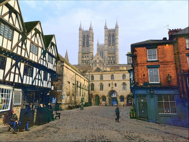 A  View to Lincoln Cathedral. A  View to Lincoln Cathedral across a cobbled, historic street scene royalty free stock photo