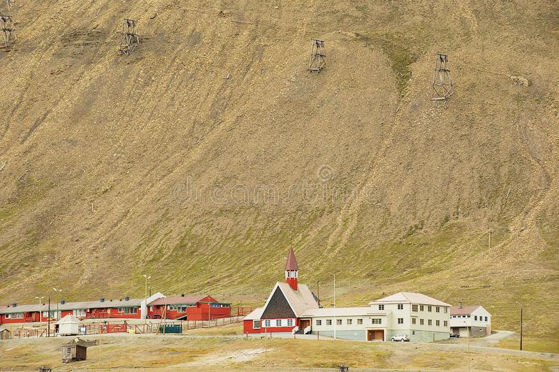 View to the lutheran church and residential buildings in Longyearbyen, Norway. stock photography