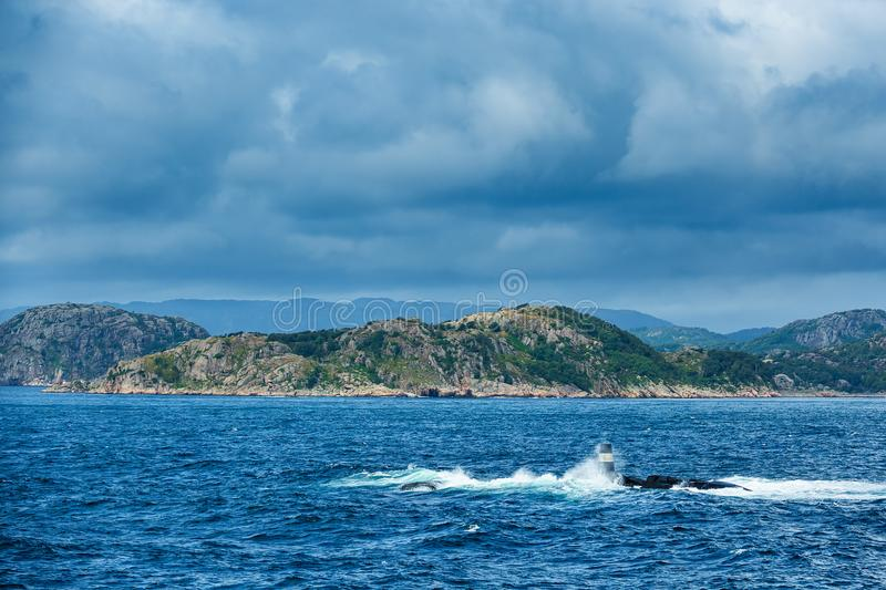View to the Lyngdalsfjord with sea mark in Norway.  royalty free stock photo