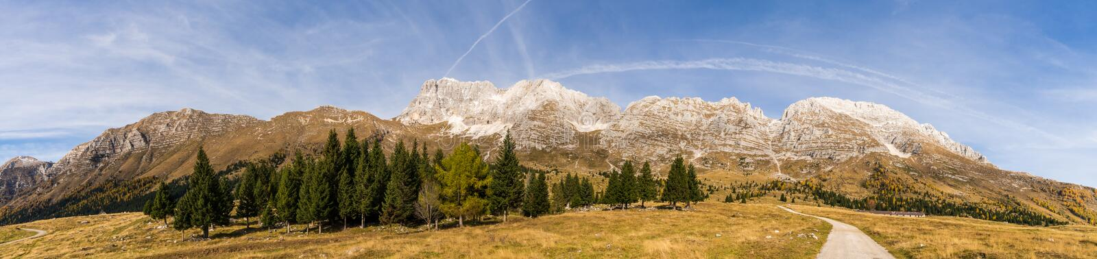 View to the Montasio Massif. Panorama view of the Montasio Massif from the souther side (Pecol Alm) at a sunny autumn day stock photography