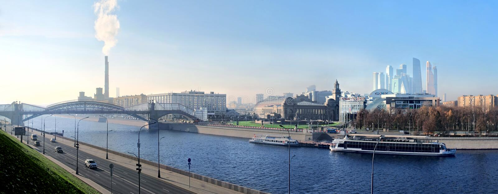 View to Moscow River with boats, bridge, Kiev Railway Station and skyscrapers of Business Center. Moscow royalty free stock photo