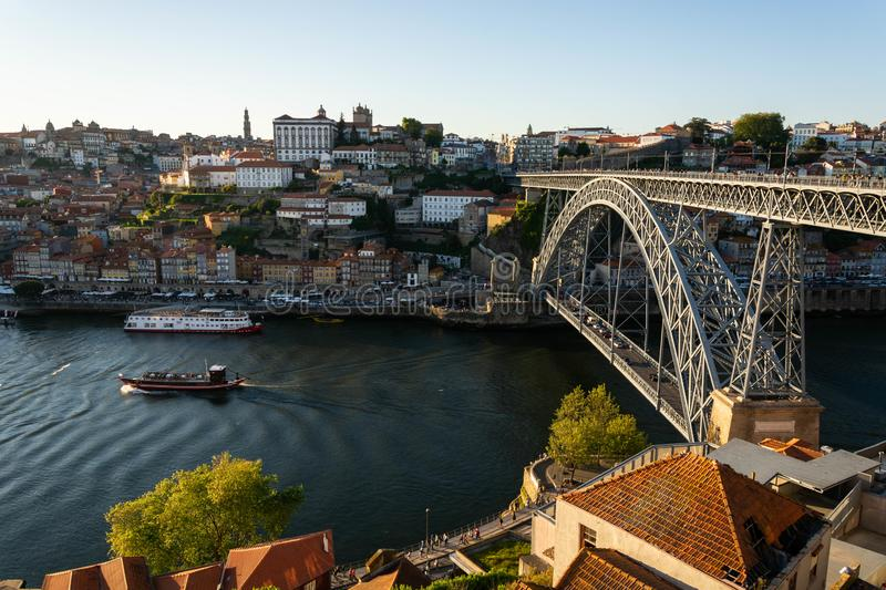 View to the old city of Porto with the D. Luis bridge and colorful buildings. Warm golden light stock photos