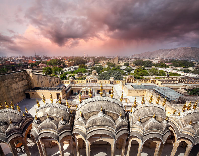 View to Old Jaipur city. Sight from the roof of Hawa Mahal Palace at purple overcast cloudy sky in Rajasthan, India royalty free stock photography