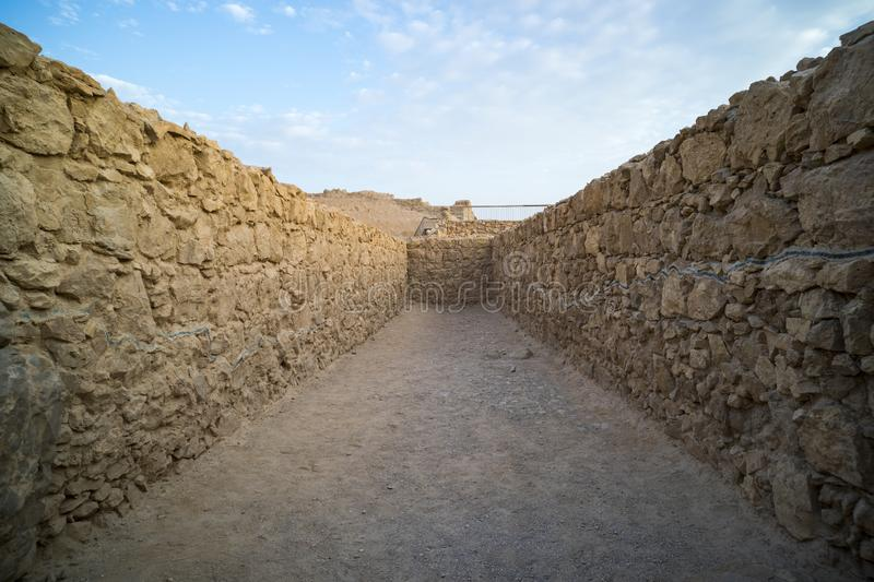 View to old stone blind alley. Architecture of ancient civilization. Masada paths and passages, Israel. Labyrinth dead-end. royalty free stock photos