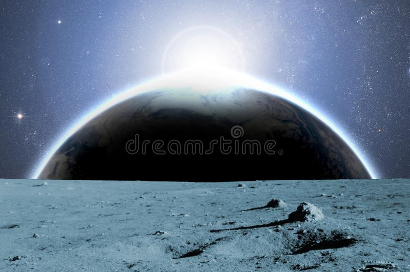 View to planet earth from moon surface b. elements of this image furnished by nasa stock photography