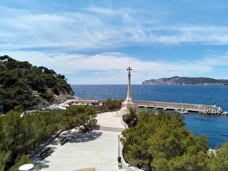 Cross symbol located in Santa Ponsa marina port. View to the religious monument Cross symbol located in Santa Ponsa marina port view to the Mediterranean Sea royalty free stock photos