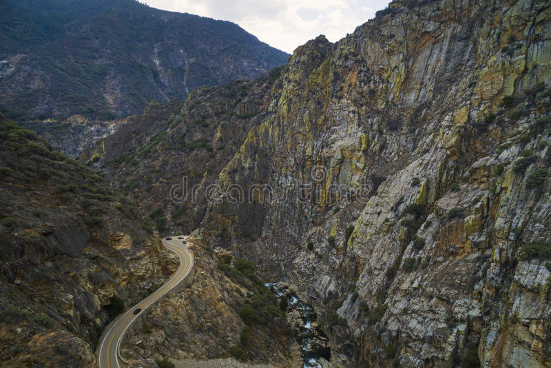 View to the road along Kings Canyon, California, USA. Kings Canyon National Park is a U.S. National Park in the southern Sierra Nevada, east of Fresno stock photography