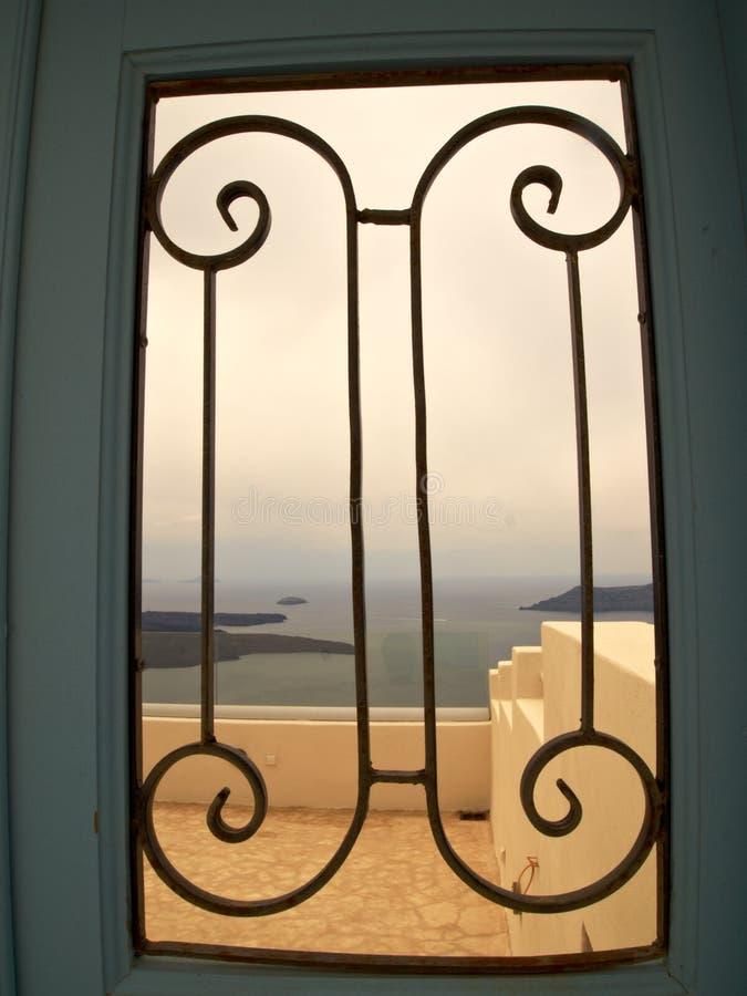 View to the sea through iron gate stock images
