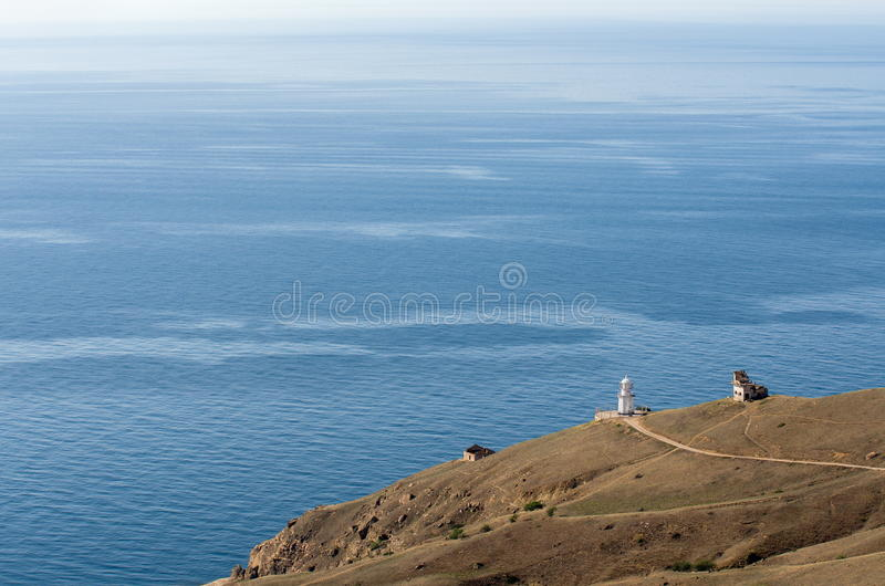 View to sea and lighthouse building. Meganom cape, Crimea, Ukraine royalty free stock photo
