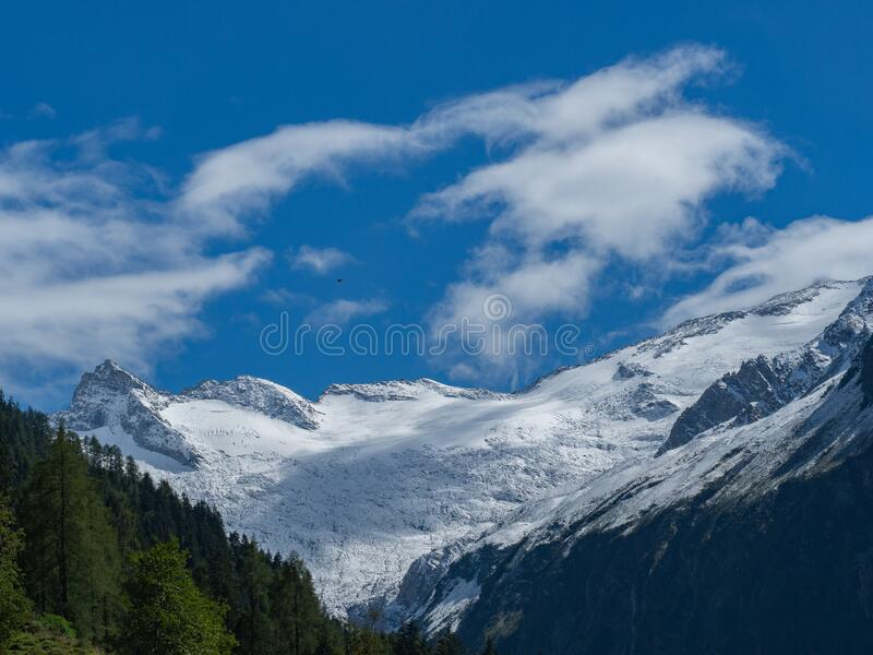 View to snowcapped mountain range. On a sunny day royalty free stock images