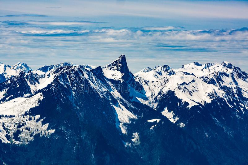 View from the Niederhorn Beatenber Mountain in Switzerland. View to the Stockhorn mountain summit from the Niederhorn in the Bernese Alps in Switzerland royalty free stock photos