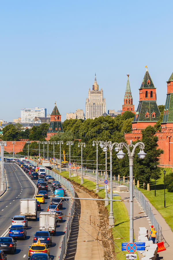 View to street on Kremlin Embankment and towers of Kremlin Wall. MOSCOW June 20: View to street on Kremlin Embankment and towers of Kremlin Wall on 20 June 2016 stock image