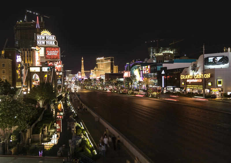 View to the Strip in Las Vegas by night with cars on the street royalty free stock photography