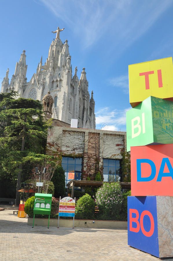 View to Temple Sacred Heart of Jesus and blocks with letters of red, blue, green and yellow colors. Amusement park Tibidabo in Bar royalty free stock photography