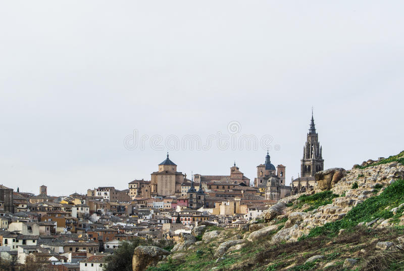 A view to Toledo old town and Cathedral from a viewpoint over the hill at surroundings of the town royalty free stock image
