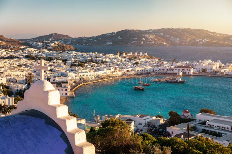 View to the towns cape and old port of Mykonos island, Greece. With blue domed churches and whitewashed houses during summer sunset time royalty free stock photos