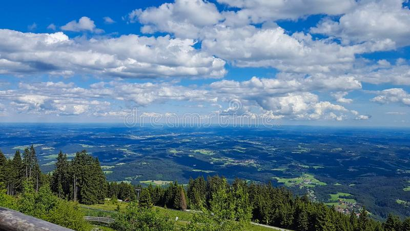 view to a valley with cloudy sky royalty free stock image