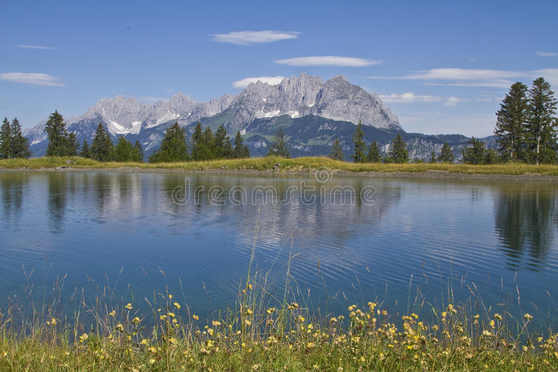 View to Wilder Kaiser mountains. Idyllic small mountain lake in front of the summit of the Wilder Kaiser royalty free stock image