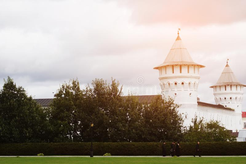 Russia, Tobolsk. View of the Tobolsk Kremlin, Dali are priests. Summer, evening sunset. Christianity stock photo