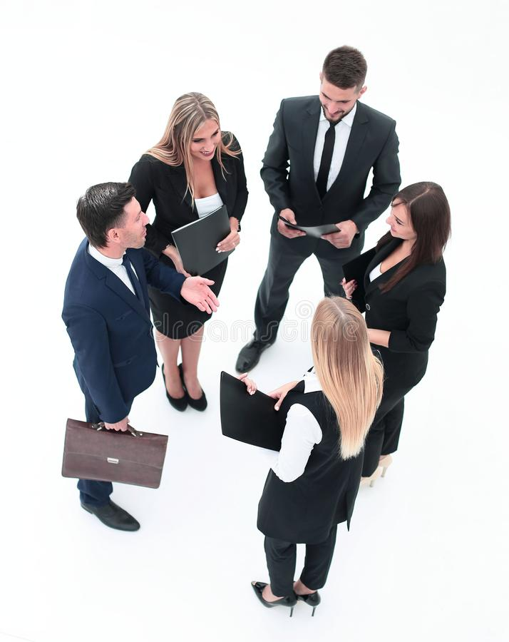 View from the top.business team discussing working papers. stock photography