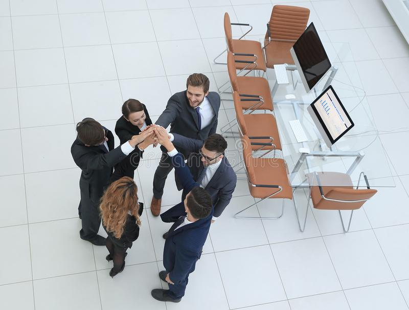View from the top .business team doing high five. The concept of teamwork stock photography