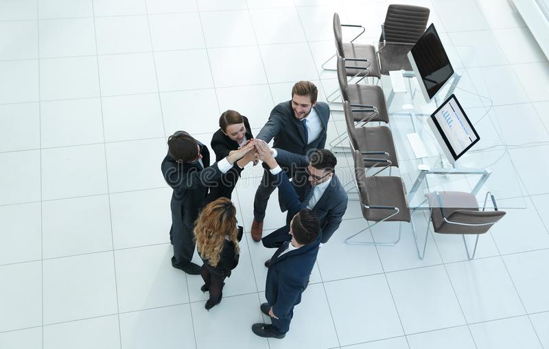 View from the top .business team doing high five. The concept of teamwork royalty free stock photo